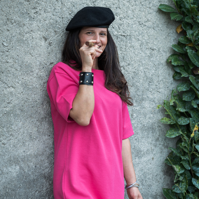 """girl with dark hair smokes a big cigar wearing a black beret"" stock image"