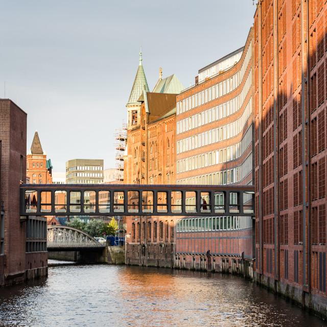 """The Warehouse District or Speicherstadt in Hamburg. Wandrahmsfleet canal"" stock image"