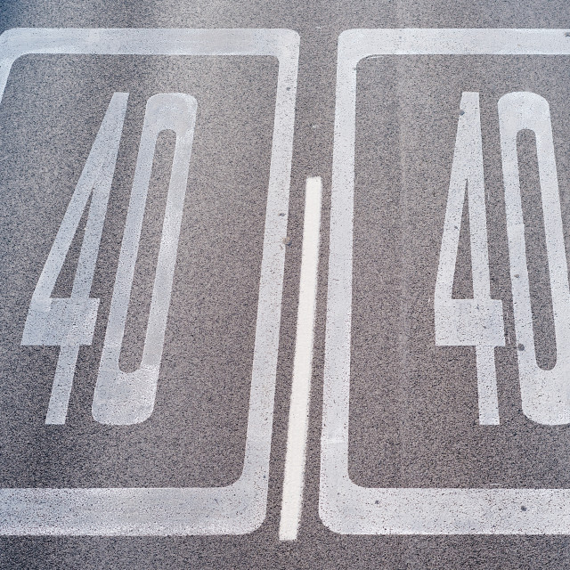 """""""Forty Kilometers or Miles Per Hour Speed Limit Sign in Road Paint"""" stock image"""