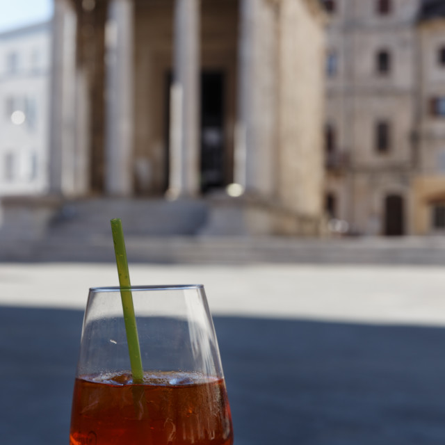 """""""Cocktail glass and Temple of Augustus on the background"""" stock image"""