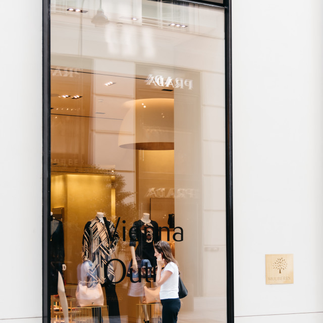 """""""Young woman in front of luxury fashion storefront in Vienna"""" stock image"""