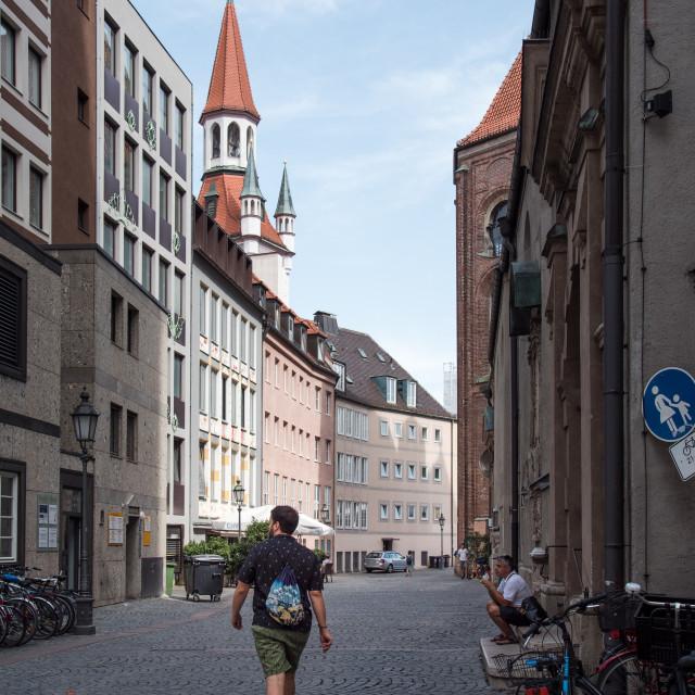 """Unidentified tourist walking on street in Munich"" stock image"