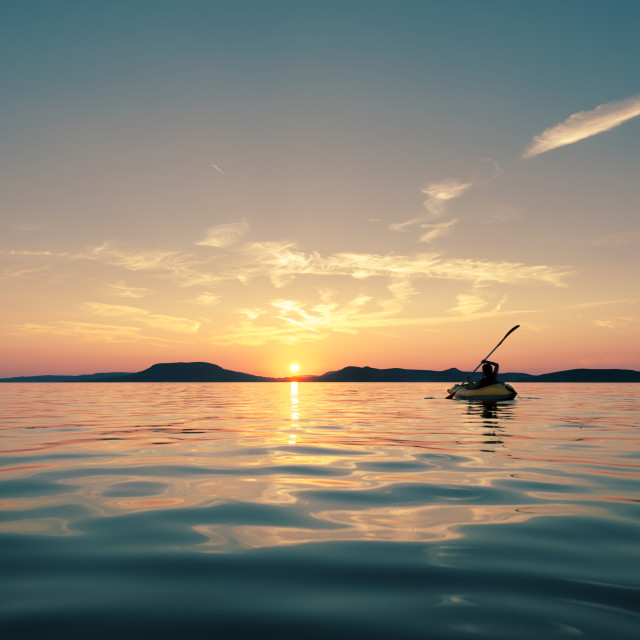 """Paddling into the sunset"" stock image"