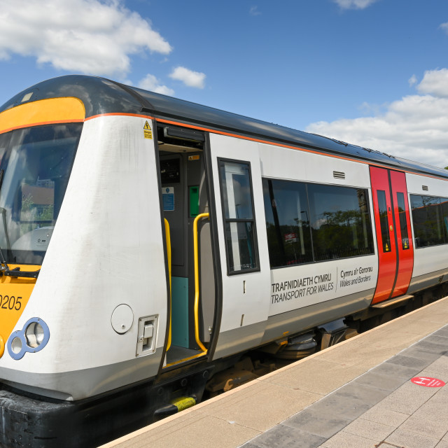 """""""Passenger train in the new colours of Transport for Wales."""" stock image"""