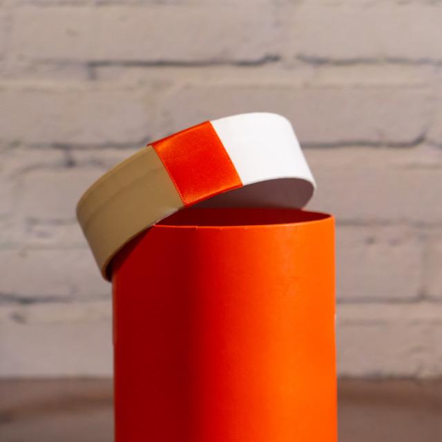 """Orange color cylindrical christnas gift box"" stock image"