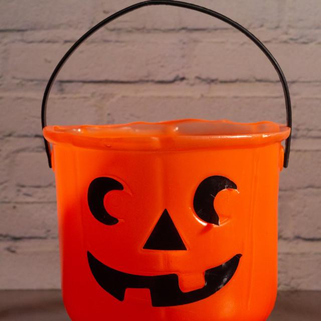 """Carved pumpkin shaped candy basket"" stock image"