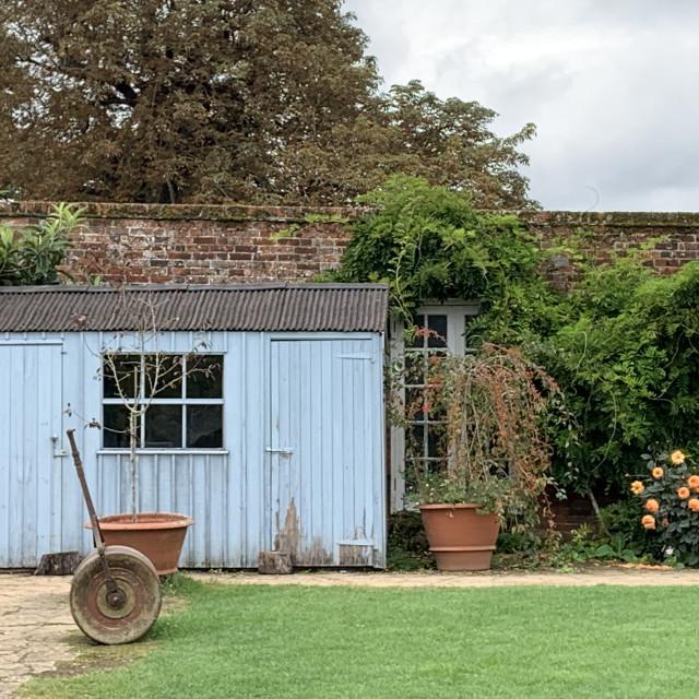 """Blue wooden potting shed"" stock image"