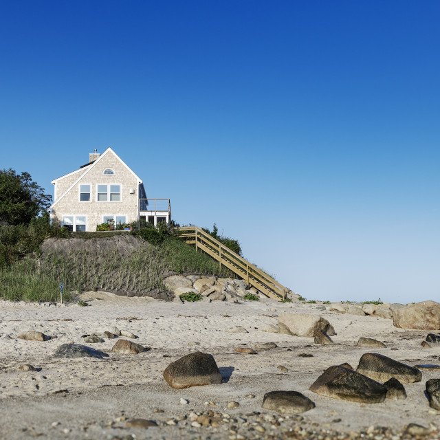 """Waterfront beach house at Point of Rocks Beach"" stock image"