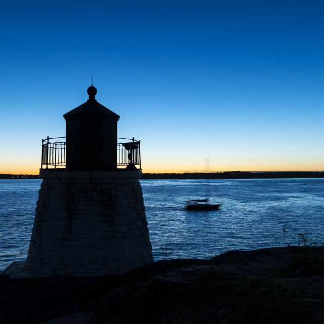 """Boat passing Castle Hill Lighthouse"" stock image"