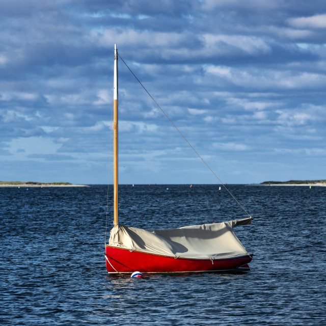 """Red sailboat anchored in Chatham Harbor"" stock image"