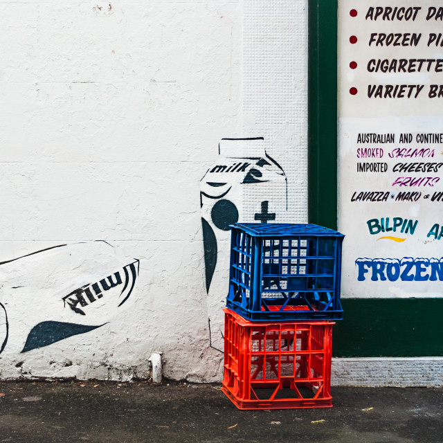 """Milk crates in front of a wall with milk carton street art"" stock image"