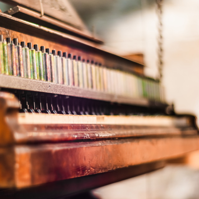 """Antique piano from the front with shallow depth of field"" stock image"