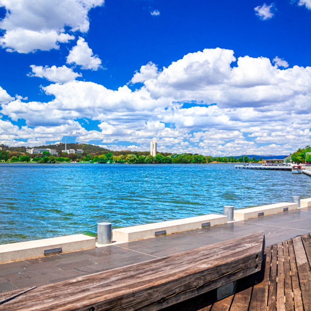 """Vertical image of a lakeside boardwalk on a sunny day in Canberra, Australia"" stock image"