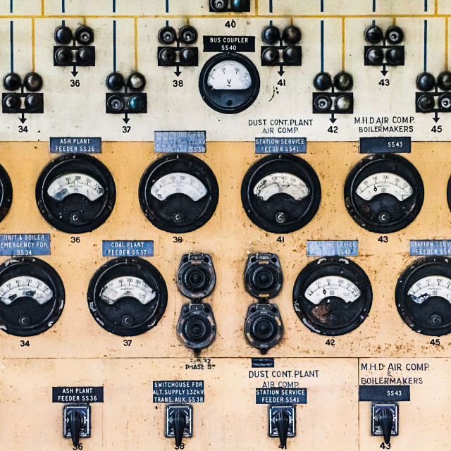 """Panel of meters, dials and switches in an abandoned power station"" stock image"