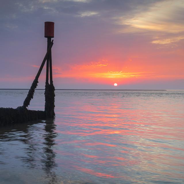 """Sunrise, Felixstowe Ferry, Suffolk"" stock image"