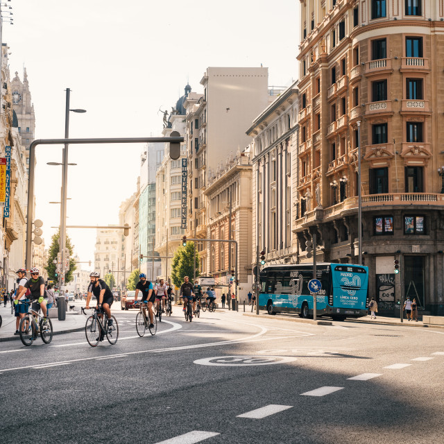 """Cyclists riding on an empty Gran Via Avenue during Covid-19 pandemic lockdown in Madrid"" stock image"