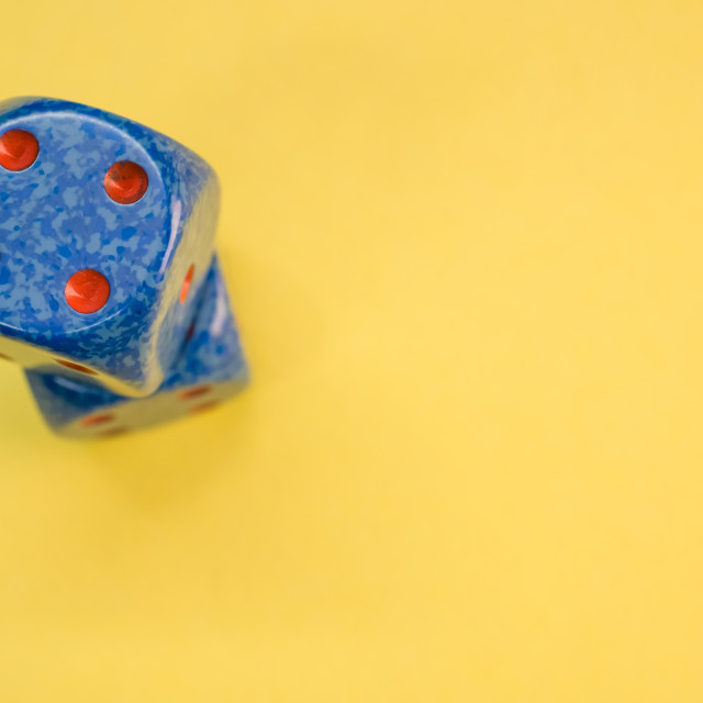 """""""two dice on a colorful surface"""" stock image"""
