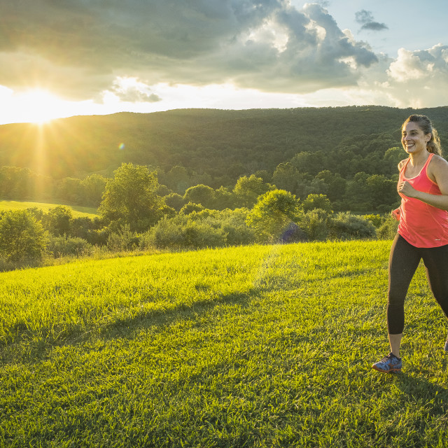 """""""runner outdoors at sunset."""" stock image"""