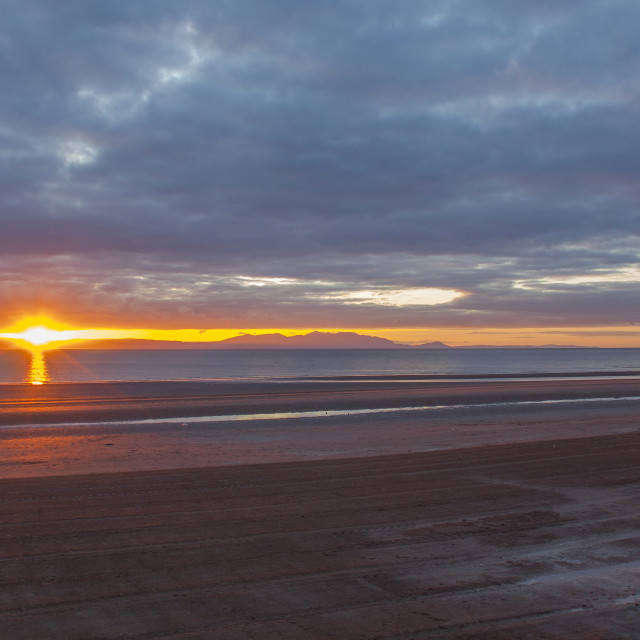 """Ayr Beach, looking to the Isle of Arran, Scotland at Sunset"" stock image"