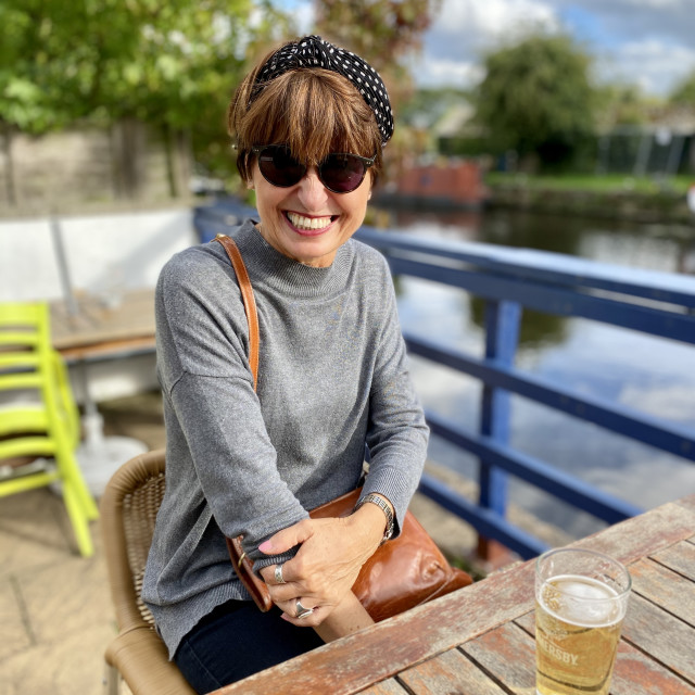 """""""Woman enjoying a beer at the pub in the UK"""" stock image"""