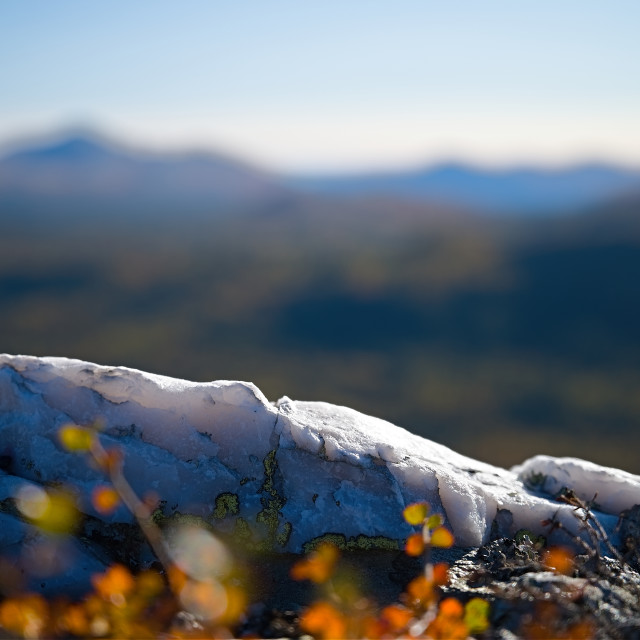 """""""White stone with a blurry landscape in background"""" stock image"""