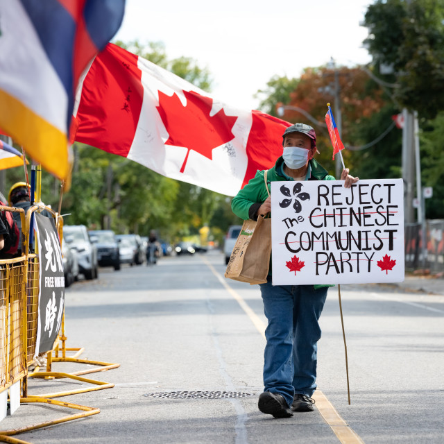 """""""Man from Hong Kong Protests The Chinese Communist Party"""" stock image"""