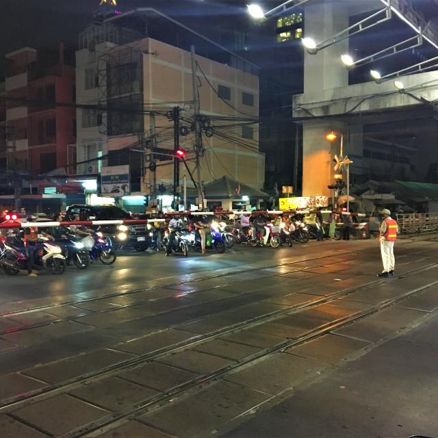 """""""Local Bangkok traffic waiting at a rail crossing"""" stock image"""