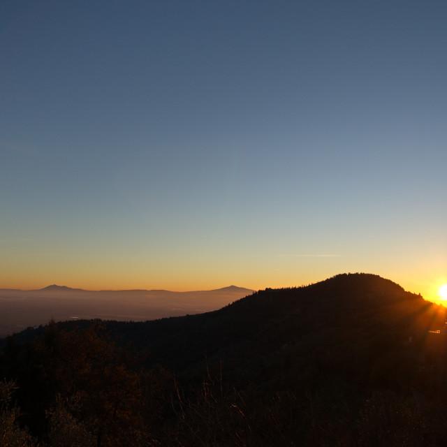"""""""View of Cortona and the Valdichiana at sundown"""" stock image"""