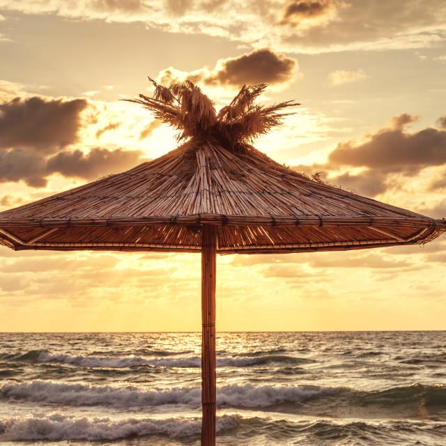 """Straw umbrella on tropical sea beach"" stock image"