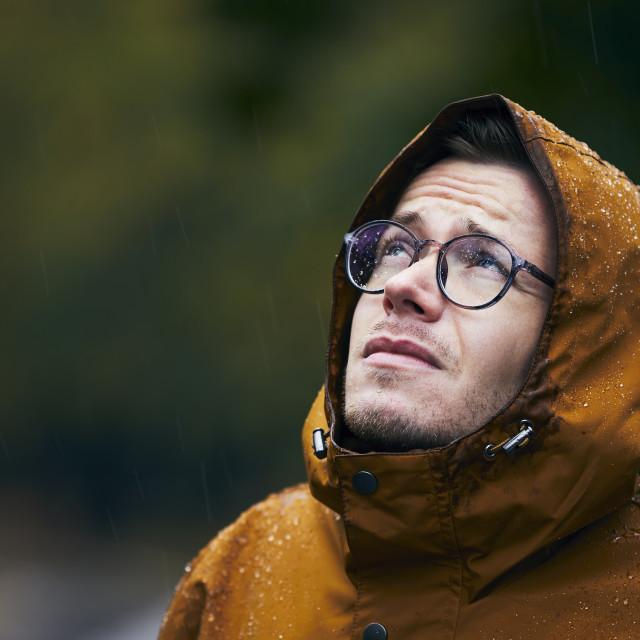 """Man in waterproof jacket during rain"" stock image"