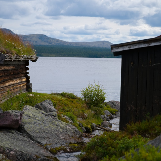 """""""Two cabins beside lake"""" stock image"""