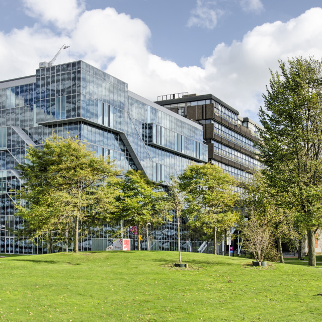 """""""Delft, The Netherlands, October 4, 2020: the campus of Delft University of Technology on a sunny day in autumn with the building for civil engineering"""" stock image"""