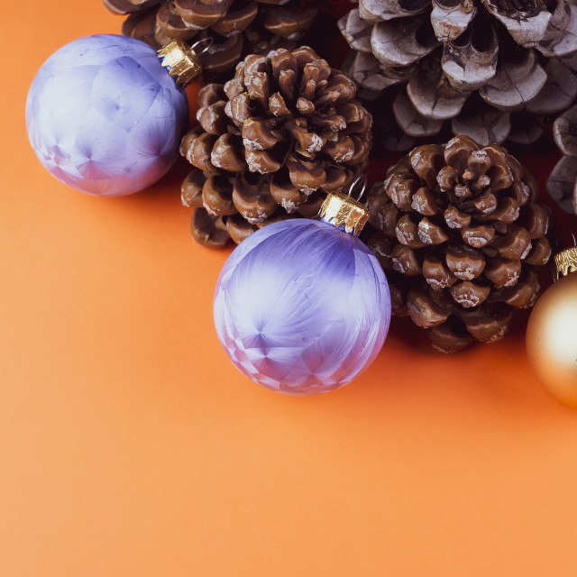 """""""Vertical shot of assorted decorative pine cones, gold and purple Christmas..."""" stock image"""