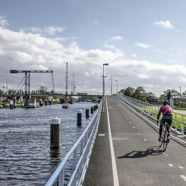 """River Schie pedestrian and cyclist bridge"" stock image"