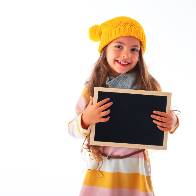 """""""Happy smiling beautiful young girl showing blank signboard or co"""" stock image"""