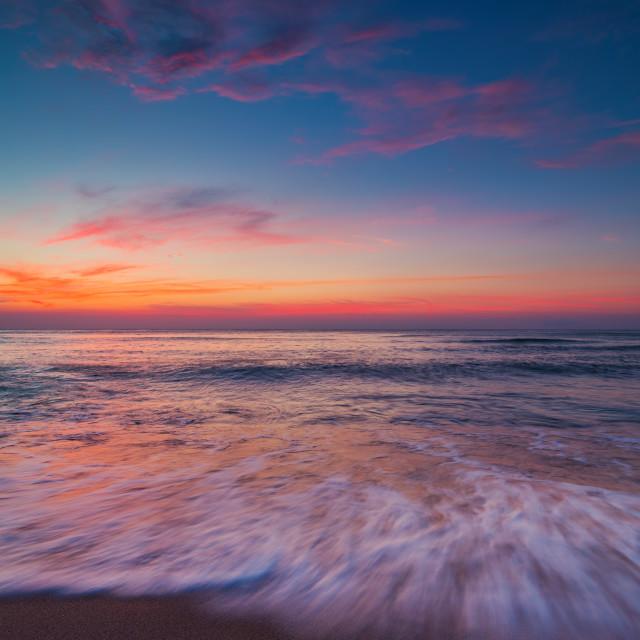 """Beach sunrise over the tropical sea"" stock image"