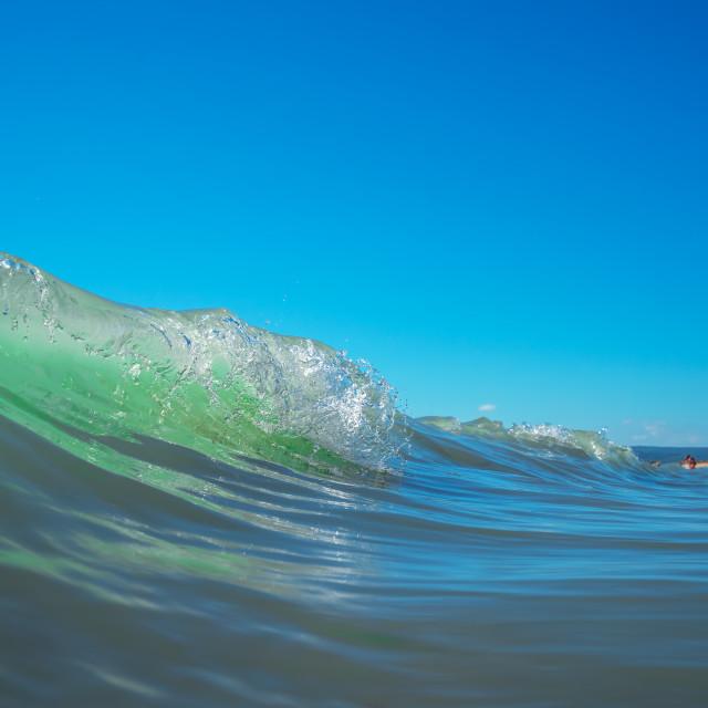 """Sea wave close up, low angle view, sunrsie shot"" stock image"