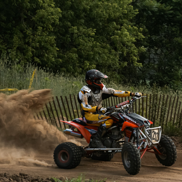 """ATV Cornering with Dust Cloud"" stock image"