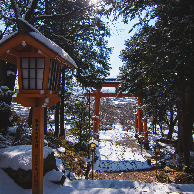 """Japanese Trail Lamps by Large Japanese Gate. Pole Translation: A"" stock image"