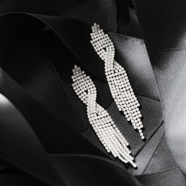 """Luxury diamond earrings on black silk ribbon as background, jewe"" stock image"