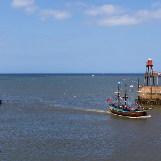 """""""Whitby harbour with a sailing boat"""" stock image"""