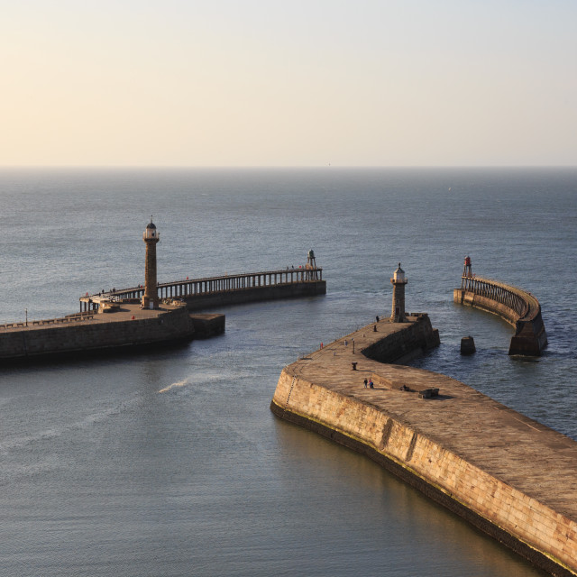 """""""Whitby harbour and lighthouses view"""" stock image"""