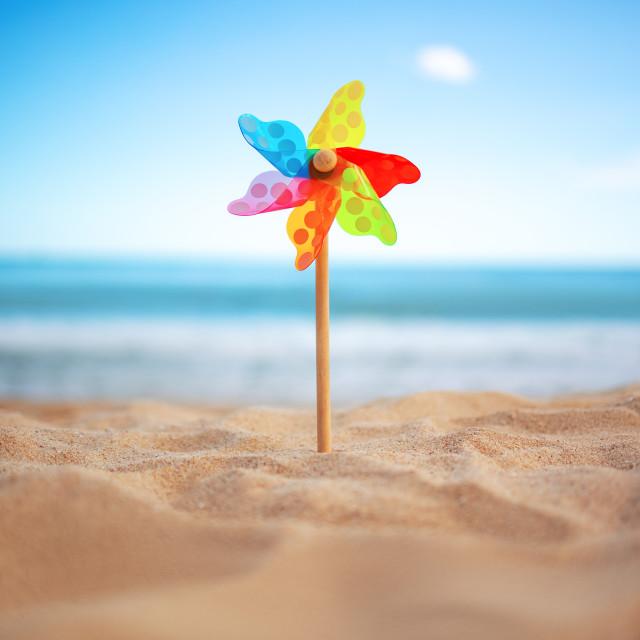 """Pinwheel on a beach sand against blue sky and sea, summer vacati"" stock image"