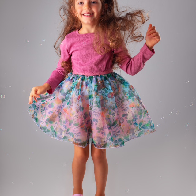 """""""Happy birthday girl in party dress portrait with copyspace for t"""" stock image"""