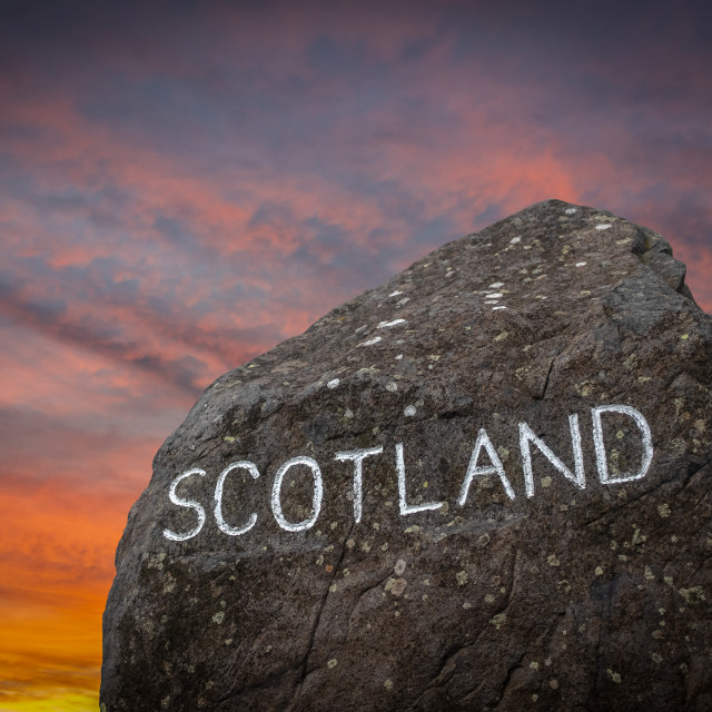 """The Scottish Border Sign At Sunset"" stock image"