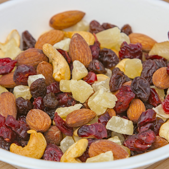 """a bowl of mixed nuts and dried fruit"" stock image"