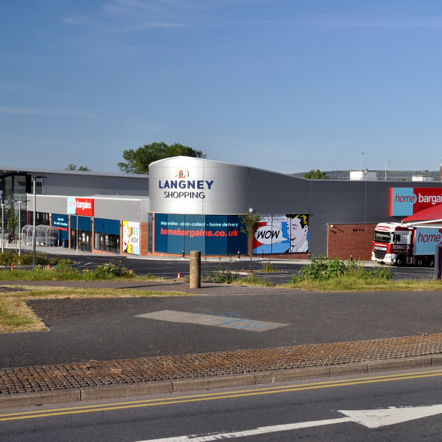 """""""shopping centre on a sunny morning with Home Bargains delivery truck. Langney Shopping Centre, Eastbourne, England. Early sunny morning with almost empty car park."""" stock image"""