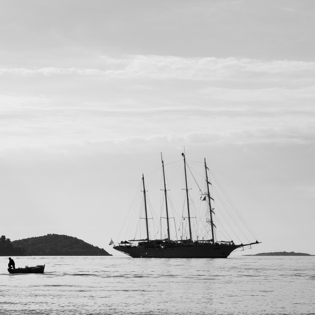 """""""Silhouette of contrasting boats on the Peljesac Channel"""" stock image"""