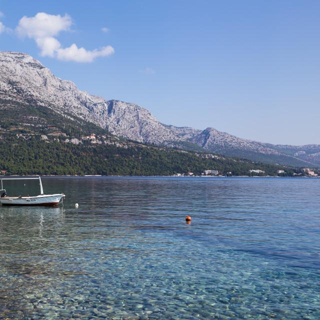 """Fishing boat under Podgorje mountain"" stock image"