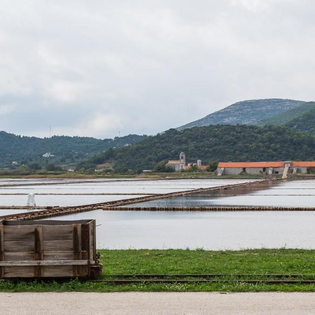 """Wooden rail cart in Ston Salt pans"" stock image"